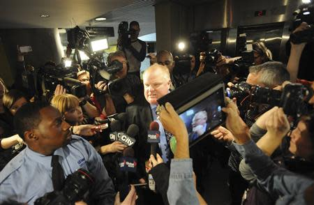 Toronto Mayor Ford is surrounded by the media as he returns to a city council meeting after a lunch break in Toronto
