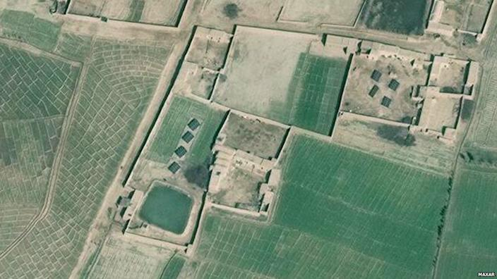 A zoomed-in satellite image shows the banks of solar panels in a farm in the Helmand river valley