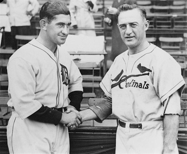 "FILE - In this Oct. 3, 1934 file photo, Detroit Tigers manager Mickey Cochrane, left, and St. Louis Cardinals manager Frankie Frisch shake hands before the start of the opening game of the World Series in Detroit.The classic ""birds on a bat"" logo sported by Carlos Beltran and his St. Louis teammates, the Olde English ""D"" worn by Miguel Cabrera and his Detroit pals _ find a picture from the 1934 World Series between those teams and you'll recognize the jerseys. In an era when clubs frequently change their look and often wear more than a dozen uniform combinations, kind of neat to see the four remaining playoff teams dressed up in digs that date back 70 years or so. (AP Photo/File)"