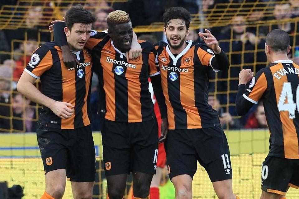 Hull City's Alfred N'Diaye (2nd L) celebrates with teammates after scoring a goal during their English Premier League match against Liverpool, at the KCOM Stadium in Kingston upon Hull, on February 4, 2017 (AFP Photo/Lindsey PARNABY)