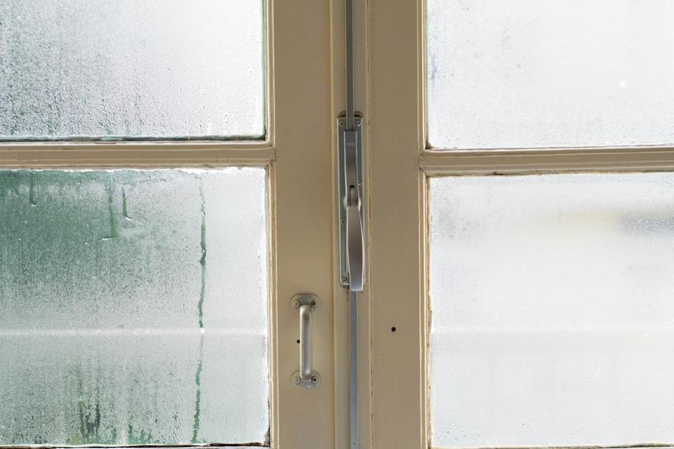 """A fogged-up window means you've got a bigger problem lurking below the surface—and one you can't afford to ignore. """"The seal on your window could be broken and warm air is coming in contact with cold air,"""" says Elron, meaning you're potentially causing your HVAC bills to skyrocket and introducing moisture—and potentially rot—into your home."""