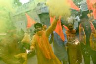 Bharatiya Janata Party (BJP) activists and supporters burn crackers and wave flags as they celebrate before the groundbreaking ceremony of the Ram Temple in Ayodhaya, in New Delhi on August 5, 2020. - India's Prime Minister Narendra Modi will lay the foundation stone for a grand Hindu temple in a highly anticipated ceremony on August 5 at a holy site that was bitterly contested by Muslims, officials said. The Supreme Court ruled in November 2019 that a temple could be built in Ayodhya, where Hindu zealots demolished a 460-year-old mosque in 1992. (Photo by Money SHARMA / AFP) (Photo by MONEY SHARMA/AFP via Getty Images)