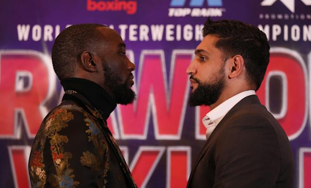 Terence Crawford (L) and Amir Khan during a news conference at The Landmark London Hotel, London. (Getty Images)