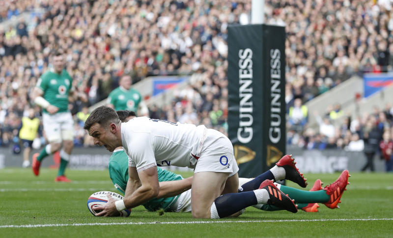England's George Ford celebrates after scoring the opening try during the Six Nations international rugby union match between England and Ireland at Twickenham stadium in London, Sunday, Feb. 23, 2020. (AP Photo/Alastair Grant)