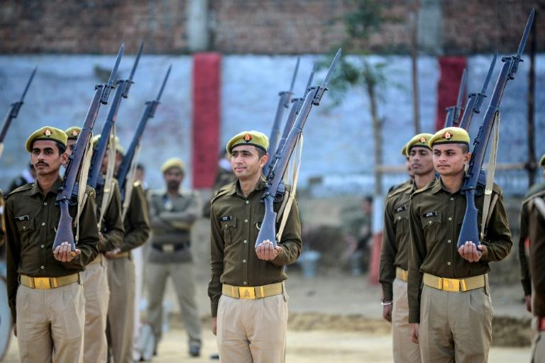 British-era bolt-action rifles were used for the last time by police in northern India during the Republic Day parade (AFP Photo/SANJAY KANOJIA)