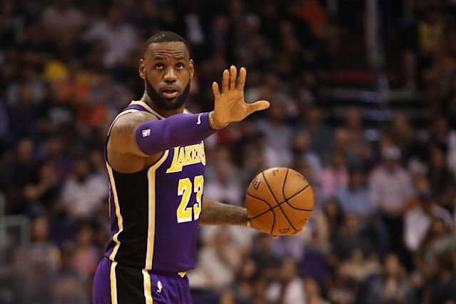 "<a class=""link rapid-noclick-resp"" href=""/nba/players/3704/"" data-ylk=""slk:LeBron James"">LeBron James</a> and the <a class=""link rapid-noclick-resp"" href=""/nba/teams/lal"" data-ylk=""slk:Los Angeles Lakers"">Los Angeles Lakers</a> cruised to their first win of the season on Wednesday night against the <a class=""link rapid-noclick-resp"" href=""/nba/teams/pho"" data-ylk=""slk:Phoenix Suns"">Phoenix Suns</a>. (Getty Images)"