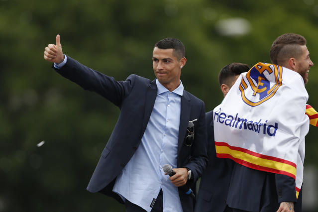 Real Madrid's Cristiano Ronaldo gestures to supporters as he celebrates with teammates after winning the Champions League final soccer match, at the Cibeles square in Madrid, Spain, Sunday, May 27, 2018. (AP Photo/Francisco Seco)
