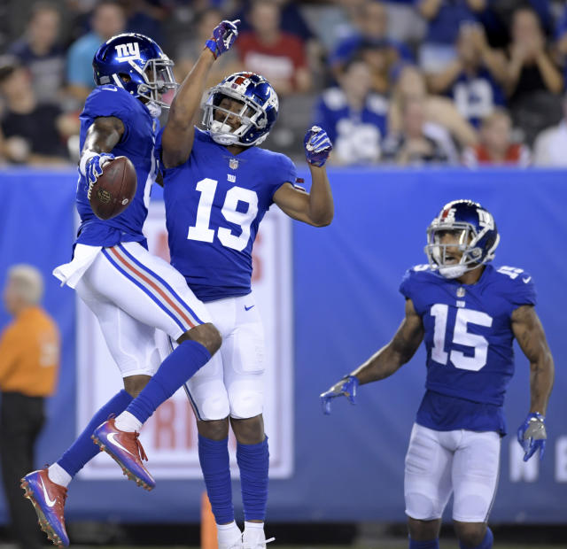 New York Giants wide receiver Amba Etta-Tawo, left, celebrates his touchdown catch with teammates wide receiver Travis Rudolph (19) and wide receiver Hunter Sharp (15) on a pass from quarterback Kyle Lauletta, not pictured, during the first half of an NFL preseason football game against the New England Patriots, Thursday, Aug. 30, 2018, in East Rutherford. (AP Photo/Bill Kostroun)