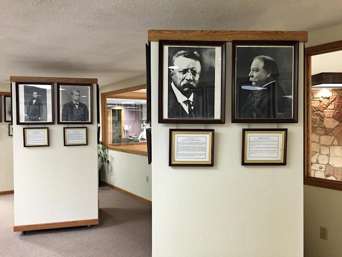 Framed photos of also-rans in the Presidential Losers Museum.