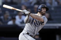 Tampa Bay Rays' Brandon Lowe hits a home run during the seventh inning of a baseball game against the New York Yankees on Saturday, Oct. 2, 2021, in New York. (AP Photo/Adam Hunger)