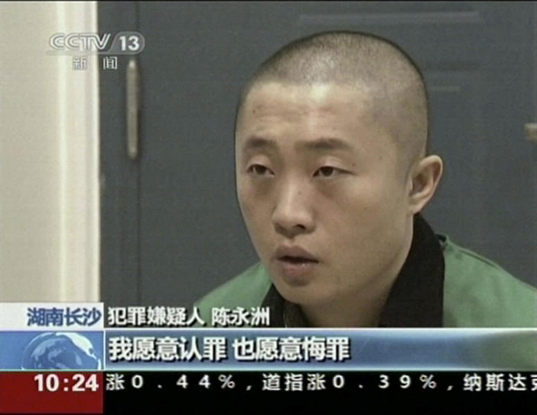 """In this image taken from an Oct. 26, 2013 video footage run by China's CCTV via APTN, Chinese journalist Chen Yongzhou is shown confessing on state television to getting paid to run stories smearing a heavy machinery company with the Chinese words below """"I willingly admit my crime and I repent it"""" in Changsha in south central China's Hunan province. The broadcast was the latest of several high-profile, televised confessions, a new tactic by Chinese authorities attempting to scrub information they deem harmful, illegal or false from the public domain, especially from the Internet. (AP Photo/CCTV via APTN) CHINA OUT, NO SALES, NO ARCHIVES, EDITORIAL USE ONLY"""