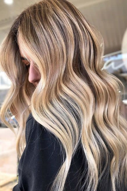 <p>Keep things low maintenance with a mix of champagne highlights and wheat blonde lowlights. If you're a sucker for bright blondes, this shade keeps you grounded. </p>