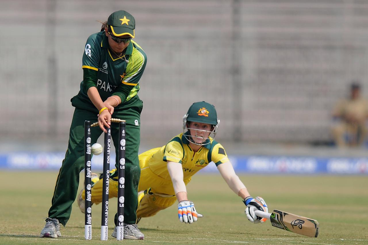 CUTTACK, INDIA - FEBRUARY 01: Rachael Haynes of Australia gets run out by Pakistan captain Sana Mir during the second match of ICC Womens World Cup between Australia and Pakistan, played at the Barabati stadium on February 1, 2013 in Cuttack, India.  (Photo by Pal Pillai-ICC/ICC via Getty Images)