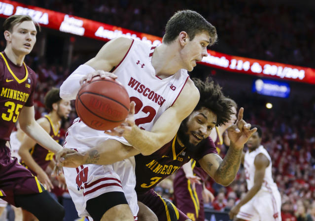 Minnesota's Jordan Murphy (3) reaches in on Wisconsin's Ethan Happ (22) during the second half of an NCAA college basketball game Thursday, Jan. 3, 2019, in Madison, Wis. Minnesota won 59-52. (AP Photo/Andy Manis)