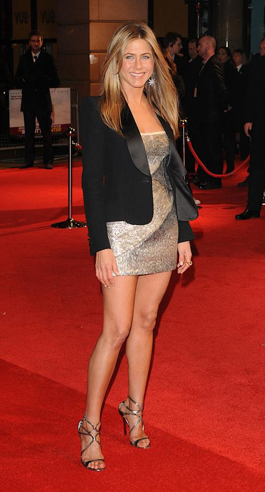 """<a href=""http://movies.yahoo.com/movie/1810129411/info"">The Bounty Hunter</a>"" London Premiere (2010)    She knows how to work a short dress on the red carpet, but mixes this mini up with a chic blazer. The Fall 2009 Valentino couture dress may catch your eye with its sparkle, but it's the strappy Jimmy Choos that direct the eye to her legs."