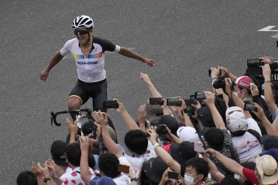 Richard Carapaz of Ecuador reacts after winning the men's cycling road race at the 2020 Summer Olympics, Saturday, July 24, 2021, in Oyama, Japan. (AP Photo/Christophe Ena)