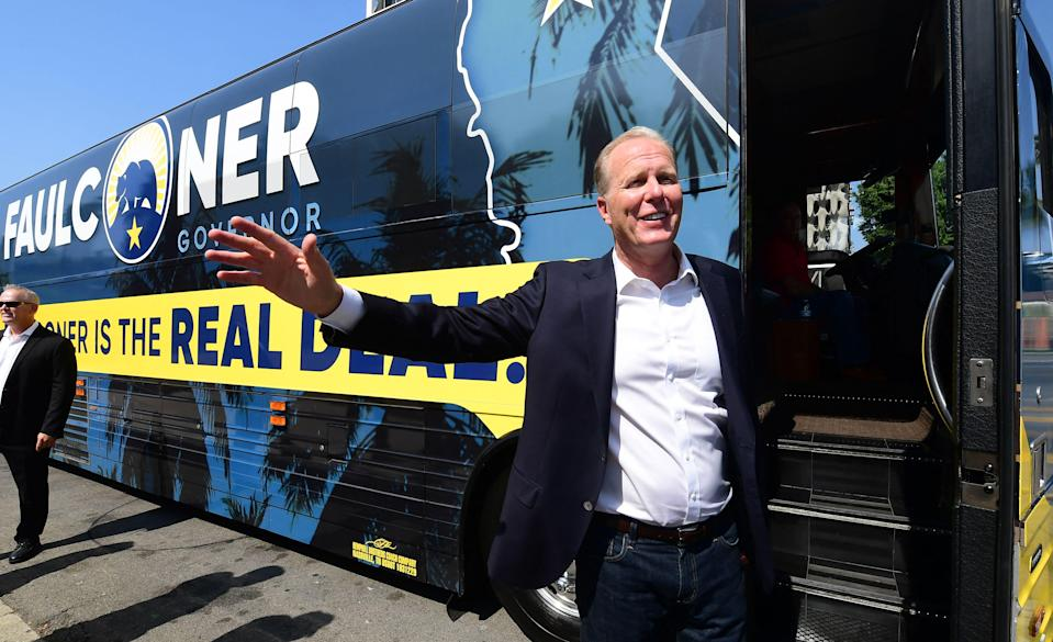 California Recall Election Republican candidate Kevin Faulconer waves while boarding his bus after stopping in Los Angeles, California, to promote his women's empowerment plan at a news conference on August 30, 2021. - The recall election for California Governor Gavin Newsom is on September 14th. (AFP via Getty Images)