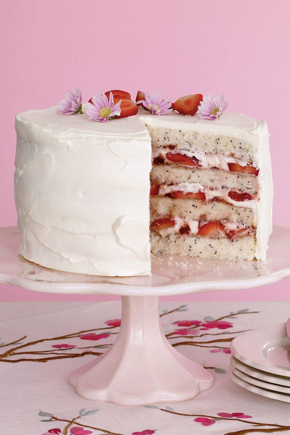 """<p>Guests will love the alternating layers of cake, fresh strawberries, and jam in this fresh cake recipe. Throw edible flowers on top for decoration.</p><p><a href=""""https://www.womansday.com/food-recipes/food-drinks/recipes/a10913/lemon-poppy-seed-cake-strawberries-recipe-122355/"""" rel=""""nofollow noopener"""" target=""""_blank"""" data-ylk=""""slk:Get the recipe for Lemon Poppy Seed Cake with Strawberries."""" class=""""link rapid-noclick-resp""""><em>Get the recipe for Lemon Poppy Seed Cake with Strawberries. </em></a></p>"""
