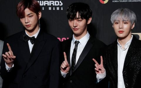 Members of South Korean music band Wanna One pose for photos on the red carpet of the Mnet Asian Music Awards (MAMA) in Hong Kong - Credit: AP