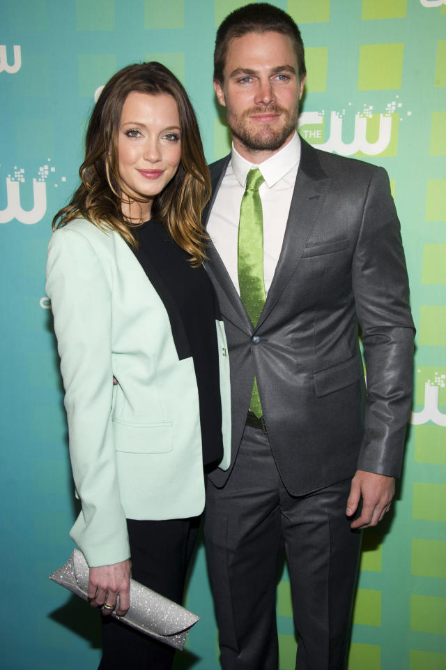 Katie Cassidy and Stephen Amell attend The CW Television Network's Upfront 2012 in New York, Thursday, May 17, 2012. (AP Photo/Charles Sykes)