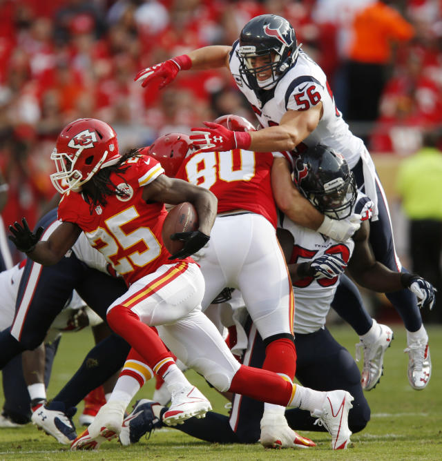 Houston Texans inside linebacker Brian Cushing (56) dives over blockers going after Kansas City Chiefs running back Jamaal Charles (25) during the first half of an NFL football game at Arrowhead Stadium in Kansas City, Mo., Sunday, Oct. 20, 2013. (AP Photo/Ed Zurga)