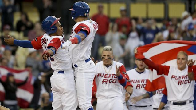<p>Puerto Rico's Carlos Correa celebrates a two-run home run with Francisco Lindor, left, against the Netherlands in the first inning of a semifinal in the World Baseball Classic in Los Angeles, Monday, March 20, 2017. (AP Photo/Chris Carlson) </p>
