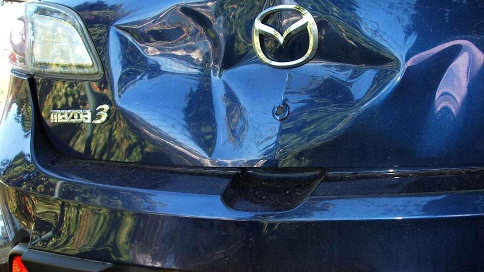 Car bootlid damaged in an accident