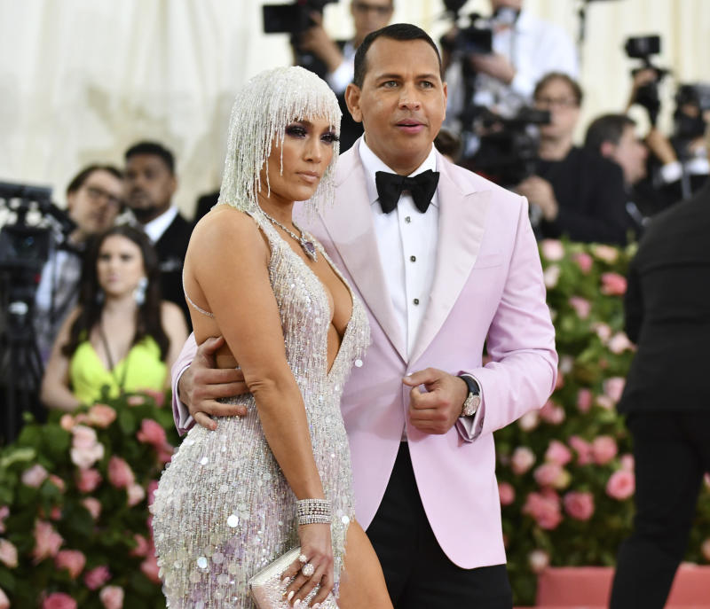 "Jennifer Lopez, left, and Alex Rodriguez attend The Metropolitan Museum of Art's Costume Institute benefit gala celebrating the opening of the ""Camp: Notes on Fashion"" exhibition on Monday, May 6, 2019, in New York. (Photo by Charles Sykes/Invision/AP)"