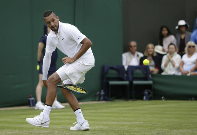 FILE - In this Tuesday, July 2, 2019, file photo, Australia's Nick Kyrgios returns the ball between his legs to Australia's Jordan Thompson in a men's singles match during day two of the Wimbledon Tennis Championships in London. (AP Photo/Tim Ireland, File)