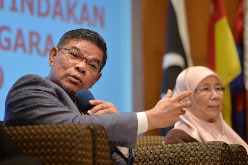 Domestic Trade and Consumer Affairs Minister Datuk Seri Saifuddin Nasution Ismail speaks during a press conference in Putrajaya June 25, 2019. ― Picture by Shafwan Zaidon
