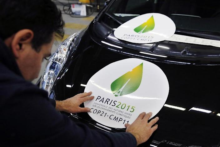 "A sticker which translates as ""Paris 2015 Conference of the United Nations on Climate Change COP21-CMP11"", on November 16, 2015 in Boulogne-Billancourt (AFP Photo/Patrick Kovarik)"
