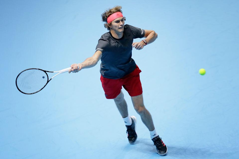 Alexander Zverev of Germany plays a return to John Isner of the United States in their ATP World Tour Finals singles tennis match at the O2 Arena in London, Friday Nov. 16, 2018. (AP Photo/Tim Ireland)