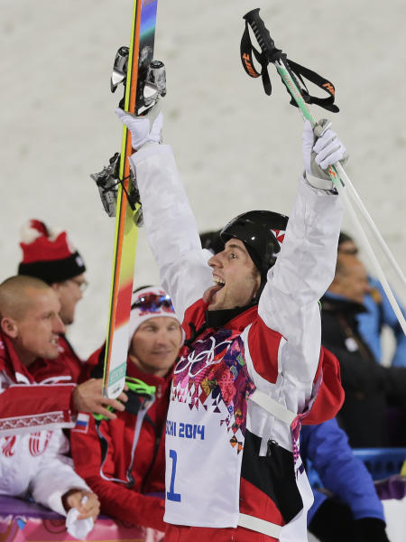 Canada's Alex Bilodeau celebrates after taking the gold medal in the men's moguls final at the Rosa Khutor Extreme Park at the 2014 Winter Olympics, Monday, Feb. 10, 2014, in Krasnaya Polyana, Russia. (AP Photo/Andy Wong)