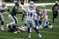 Dallas Cowboys quarterback Andy Dalton (14) scrambles out of the pocket to throw a pass in the first half of an NFL football game against the Philadelphia Eagles in Arlington, Texas, Sunday, Dec. 27. 2020. (AP Photo/Ron Jenkins)
