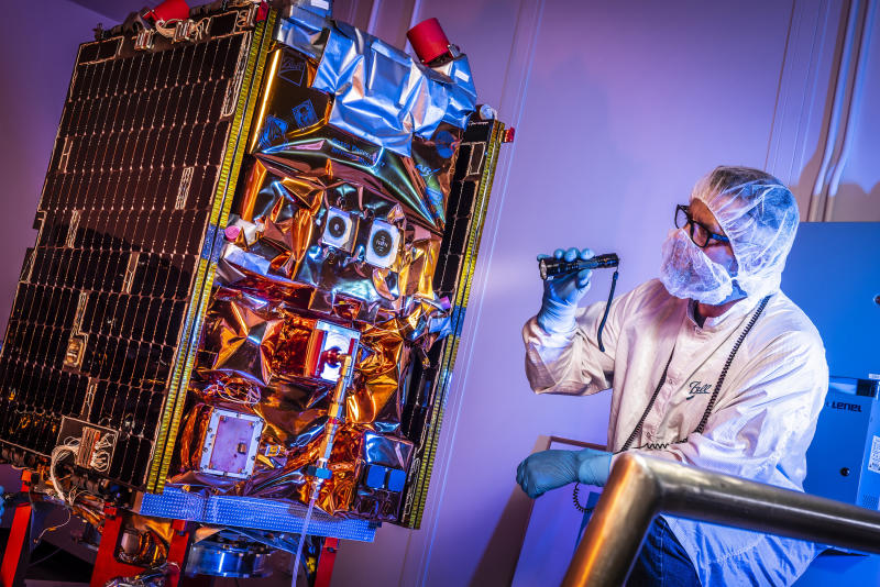 Aerospace engineer performs final checks before the GPIM satellite is shipped to Florida for launch