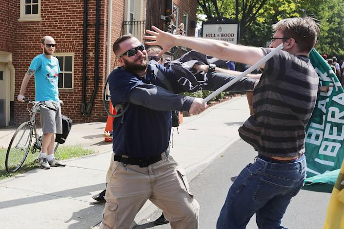 White nationalists, neo-Nazis and members of the 'alt-right' clash with counter-protesters at the march