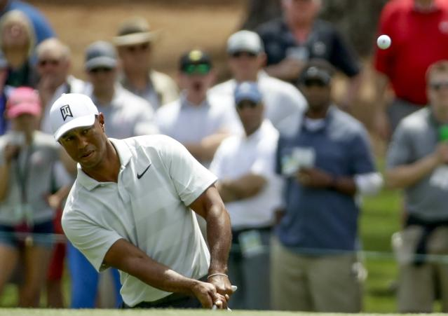 "<a class=""link rapid-noclick-resp"" href=""/pga/players/147/"" data-ylk=""slk:Tiger Woods"">Tiger Woods</a> chips to the third green during the second round at the Masters golf tournament Friday, April 6, 2018, in Augusta, Ga. (AP Photo/Chris Carlson)"