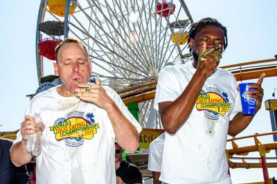 """The #1-Ranked Competitive Eater In The World, Joey Chestnut (L) of San Jose, Calif. and Gideon Oji (R) of Morrow, GA compete at the second annual Pacific Park World Taco-Eating Championship on """"National Taco Day,"""" Friday, October 4, 2019, at Pacific Park on the Santa Monica Pier in Santa Monica, Calif. Chestnut demolished 82 Pacific Park street-style carnitas tacos to defend his title and retain the Major League Eating world record. (Photos by Fabian Lewkowicz for Pacific Park)"""