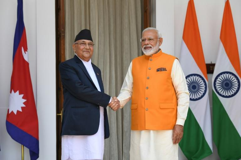 Indian Prime Minister Narendra Modi (R) shakes hands with Nepal counterpart KP Sharma Oli prior to a meeting in New Delhi on May 31, 2019 -- their countries are in a border dispute over Kalapani