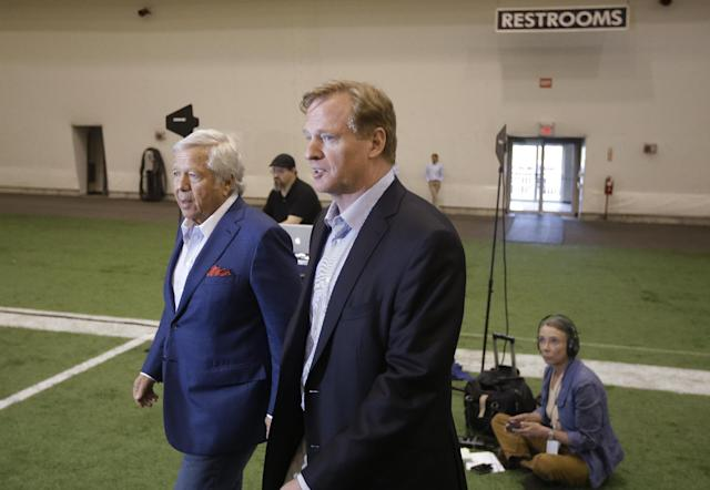 NFL Commissioner Roger Goodell, foreground, and New England Patriots owner Robert Kraft walk onto the field as they arrive at a football safety clinic for mothers, Thursday, May 29, 2014 at the team's facilities in Foxborough, Mass. (AP Photo/Stephan Savoia)