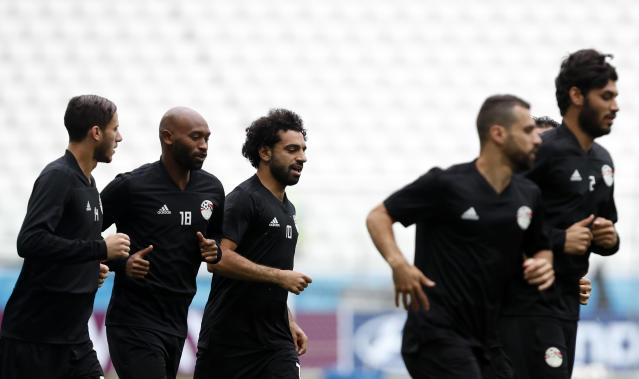 Players run during Egypt's official training on the eve of the group A match between Saudi Arabia and Egypt at the 2018 soccer World Cup in the Volgograd Arena, in Volgograd, Russia, Sunday, June 24, 2018. (AP Photo/Darko Vojinovic)