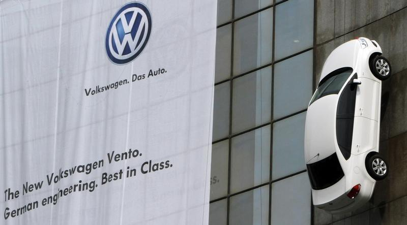 "The new Volkswagen's ""Vento"" car hangs on display from a building during its launch in New Delhi"