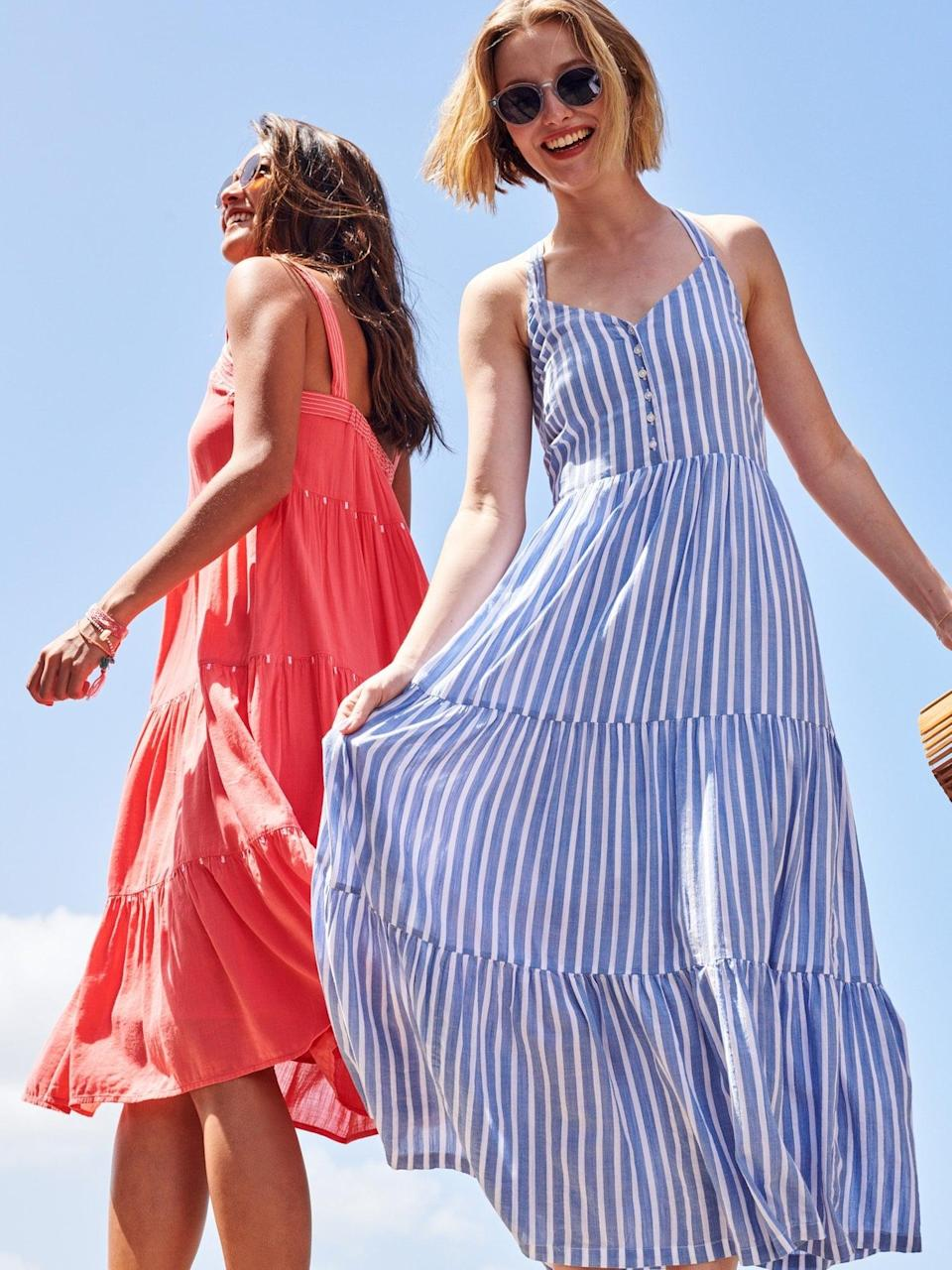 """<p>This <a href=""""https://www.popsugar.com/buy/Old-Navy-Striped-Fit-amp-Flare-Tiered-Maxi-Sundress-586318?p_name=Old%20Navy%20Striped%20Fit%20%26amp%3B%20Flare%20Tiered%20Maxi%20Sundress&retailer=oldnavy.gap.com&pid=586318&price=45&evar1=fab%3Aus&evar9=47589362&evar98=https%3A%2F%2Fwww.popsugar.com%2Fphoto-gallery%2F47589362%2Fimage%2F47589365%2FOld-Navy-Striped-Fit-Flare-Tiered-Maxi-Sundress&list1=shopping%2Cold%20navy%2Cdresses%2Csummer%2Cproducts%20under%20%2450&prop13=api&pdata=1"""" class=""""link rapid-noclick-resp"""" rel=""""nofollow noopener"""" target=""""_blank"""" data-ylk=""""slk:Old Navy Striped Fit &amp; Flare Tiered Maxi Sundress"""">Old Navy Striped Fit &amp; Flare Tiered Maxi Sundress</a> ($45, originally $50) is super comfortable.</p>"""