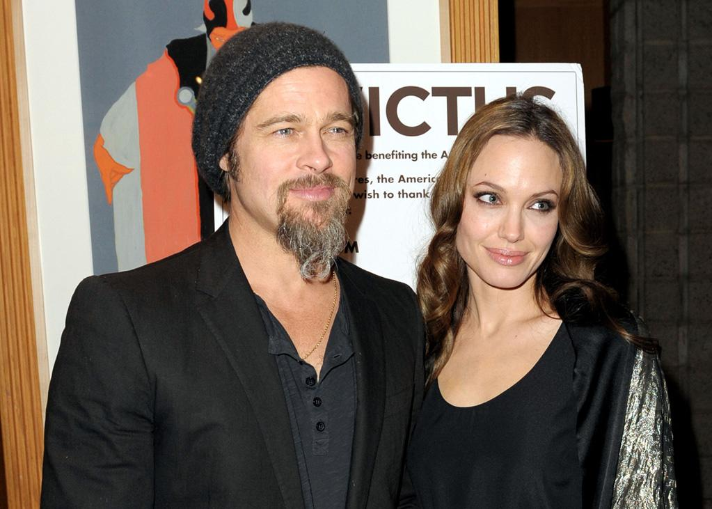 "<a href=""http://movies.yahoo.com/movie/contributor/1800018965"">Brad Pitt</a> and <a href=""http://movies.yahoo.com/movie/contributor/1800019275"">Angelina Jolie</a> at the Los Angeles premiere of <a href=""http://movies.yahoo.com/movie/1810073710/info"">Invictus</a> - 12/03/2009"