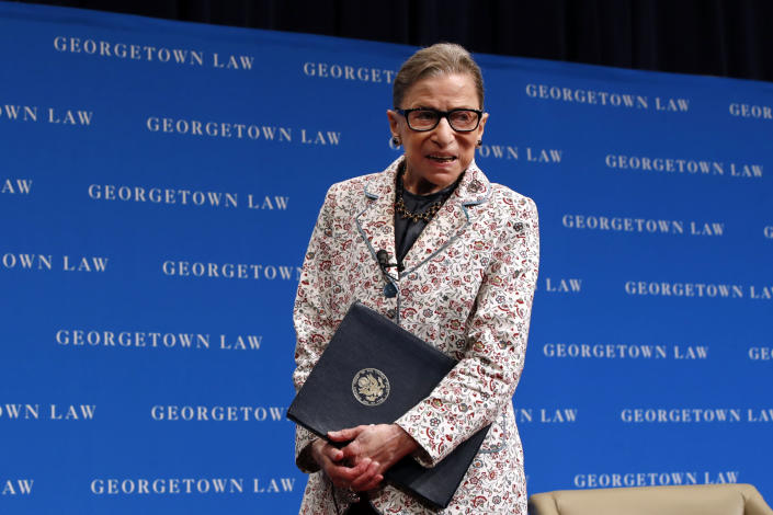FILE - In this Sept. 26, 2018, file photo, Supreme Court Justice Ruth Bader Ginsburg leaves the stage after speaking to first-year students at Georgetown Law in Washington. The Supreme Court says Ginsburg has died of metastatic pancreatic cancer at age 87. (AP Photo/Jacquelyn Martin, File)