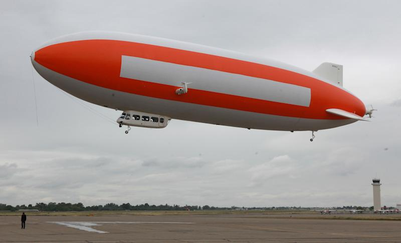 Carrying scientists and researchers, the zeppelin, Eureka lifts off from McClellan Air Park in Sacramento, Calif., to search for pieces of a meteorite, Thursday, May 3, 2012. The researchers are using an aerial search hoping to locate sites where large fragments landed after a meteor exploded in the atmosphere over the Sierra Nevada in late April. (AP Photo/Rich Pedroncelli)