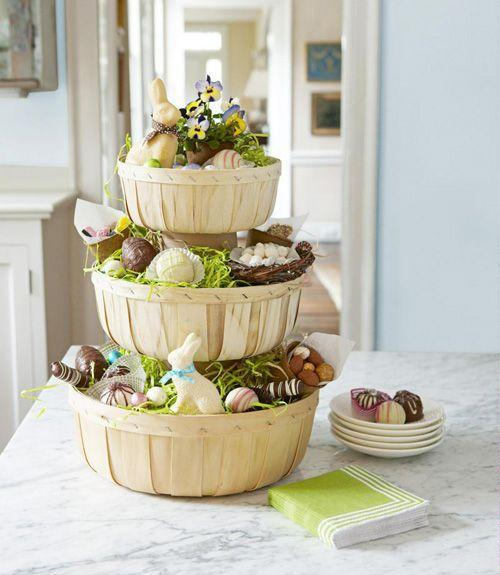 <p>To make this tower of treats, tape cut-to-fit craft paper around two empty 32-oz. yogurt cartons. Hot-glue an upside-down carton inside a large orchard basket, then glue a medium basket on top. Repeat with other carton and small basket. Finish it off with festive treats and plenty of chocolate! </p>
