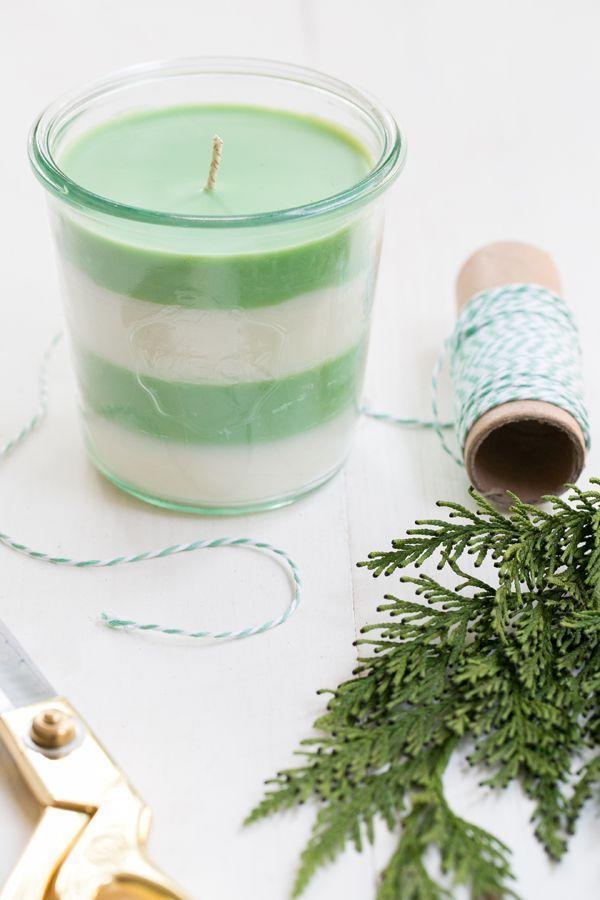"""<p>These striped candles smell positively delightful (like pine!), but they're also just really, really pretty. And that mint and white design will look lovely in your recipient's home all the way until springtime.</p><p><strong>Get the tutorial at <a href=""""https://sugarandcharm.com/2014/12/diy-pine-scented-soy-candles.html?section-1"""" rel=""""nofollow noopener"""" target=""""_blank"""" data-ylk=""""slk:Sugar and Charm"""" class=""""link rapid-noclick-resp"""">Sugar and Charm</a>.</strong></p><p><a class=""""link rapid-noclick-resp"""" href=""""https://www.amazon.com/Best-Sellers-Arts-Crafts-Sewing-Candle-Making-Supplies/zgbs/arts-crafts/262597011?tag=syn-yahoo-20&ascsubtag=%5Bartid%7C10050.g.645%5Bsrc%7Cyahoo-us"""" rel=""""nofollow noopener"""" target=""""_blank"""" data-ylk=""""slk:SHOP CANDLE MAKING SUPPLIES"""">SHOP CANDLE MAKING SUPPLIES</a> </p>"""