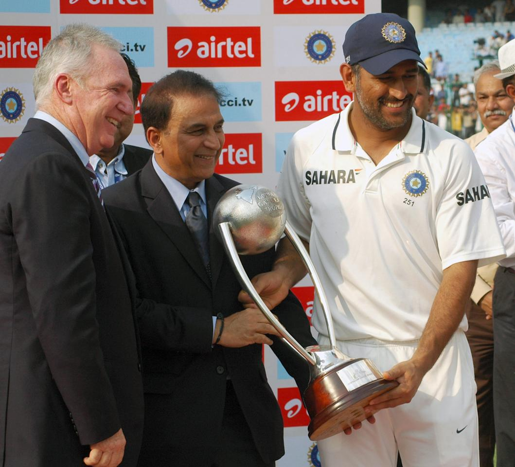 Indian Cricket Team, Captain, M S Dhoni being received the Border Gavaskar Trophy by Sunil Gavaskar after winning the Series between India & Australia at Ferozeshah Kotla Stadium in Delhi on March 24, 2013. P D Photo by Dinesh Kumar