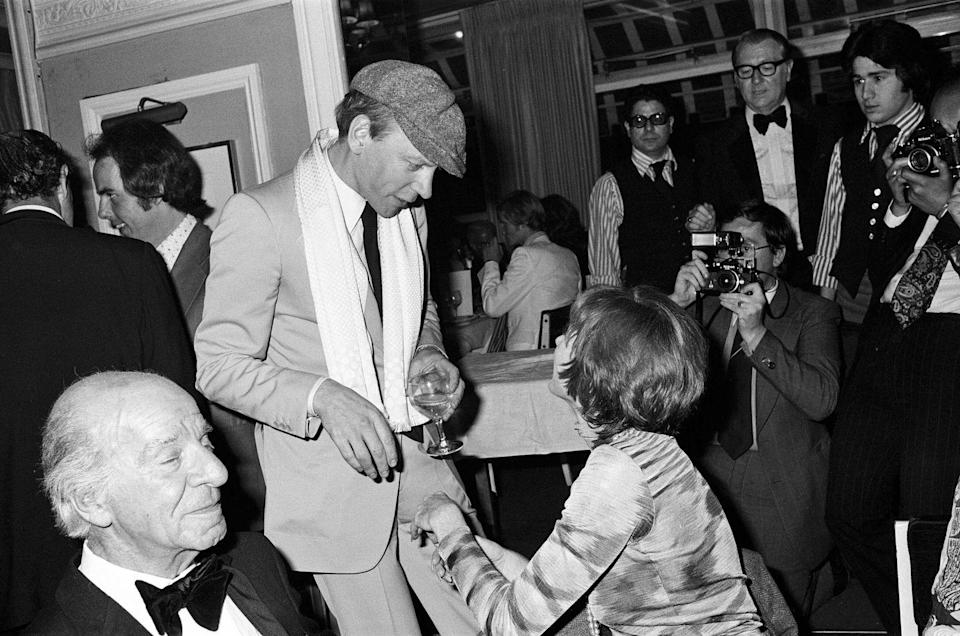 <p>Shirley MacLaine with Donald Sutherland at the White Elephant club in Westminster for a party to celebrate her appearance at the London Palladium, May 1976.</p>